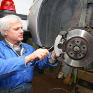 Man repairing and maintaining brake rotor